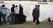 G.B. ENGLAND. London. The grieving family of Kodjo Yenga, a 16 year old boy stabbed to death by other teenagers, in the place where he died. Hammersmith, west London. 2007.