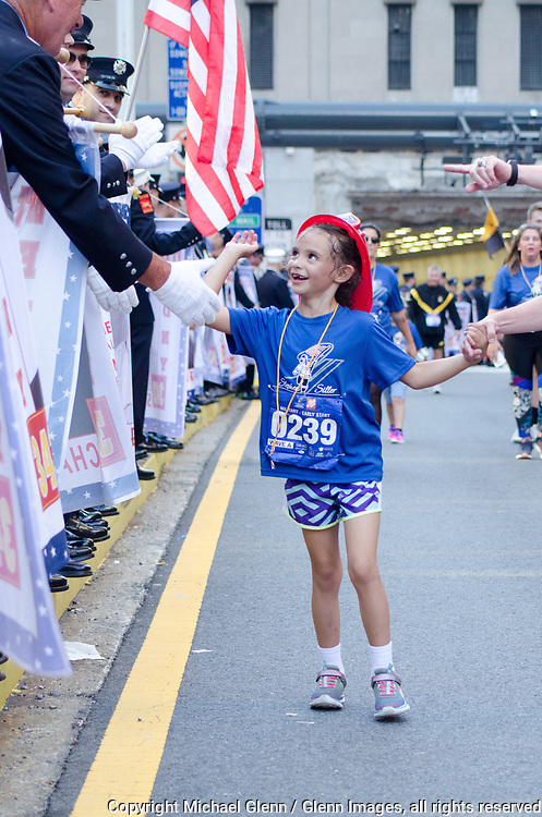 24 Sep 2017 Manhattan, New York United States of America // Little runner gives Hi Fives at the Stephen Siller Tunnel to Towers run at the World Trade Center site  Michael Glenn  /
