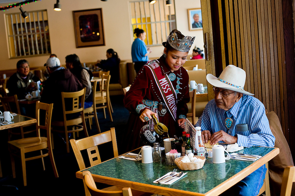 021210       Brian Leddy.Miss Northern Navajo Nation Tanya Lister pours a cup of coffee for Colbert Joe at Dine Restaurant in Window Rock Friday. Lister and several other Navajo Nation royalty donated their tip money from working at the restaurant to the Special Olympics.