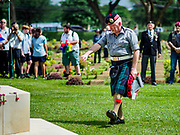 "11 NOVEMBER 2018 - KANCHANABURI, KANCHANABURI, THAILAND: STEWART WILSON, a Scottish veteran of the British army, salutes after placing a wreath on a memorial for soldiers killed working on the ""Death Railway"" during the Rememberance Day ceremony at the Kanchanaburi War Cemetery in Kanchanaburi, Thailand. Kanchanaburi is the location of the infamous ""Bridge On the River Kwai"" and was known for the ""Death Railway"" built by Japan during World War II using allied, principally British, Australian and Dutch, prisoners of war as slave labor. There are 6,982 people buried in the cemetery, including 5,000 Commonwealth soldiers and 1,800 Dutch soldiers. November 11, 2018 marked the 100th anniversary of the end of World War I, celebrated as Rememberance Day in the UK and the Commonwealth and Veterans' Day in the US.    PHOTO BY JACK KURTZ"