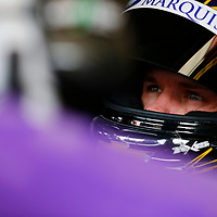 Ryan Truex (11) straps into his car to practice for the Alsco 300 at Kentucky Speedway in Sparta, Kentucky.