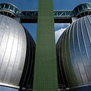 "February 19, 2015 - New York, NY : Two of the Newtown Creek Wastewater Treatment Plant's eight stainless steel-clad ""egg-shaped"" digesters can be seen rising above Greenpoint, Brooklyn. The plant is the largest of New York City's 14 wastewater treatment plants. Bacteria in the digesters break down sludge (organic material removed from sewage) into water, carbon dioxide, methane, and ""digested sludge."" The city burns the methane to create energy and uses the digested sludge as a fertilizer. CREDIT: Karsten Moran for The New York Times"