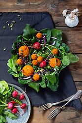 Green Salad with Turmeric Almond Dumplings and Radishes