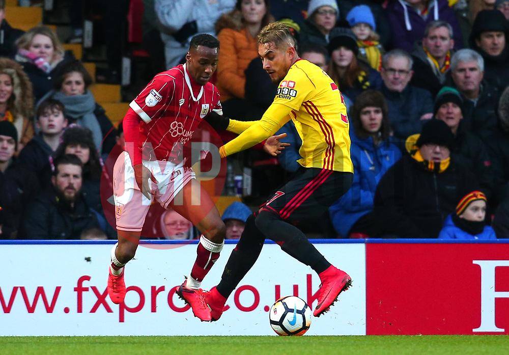 Opi Edwards of Bristol City takes on Roberto Pereyra of Watford - Mandatory by-line: Robbie Stephenson/JMP - 06/01/2018 - FOOTBALL - Vicarage Road - Watford, England - Watford v Bristol City - Emirates FA Cup third round proper
