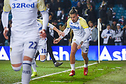 Kalvin Phillips of Leeds United (23) warming up during the EFL Sky Bet Championship match between Leeds United and West Bromwich Albion at Elland Road, Leeds, England on 1 March 2019.