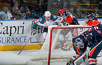 KELOWNA, CANADA - FEBRUARY 18: Travis Verveda #2 of Kamloops Blazers checks Tyrell Goulbourne #12 of Kelowna Rockets behind the net on February 18, 2015 at Prospera Place in Kelowna, British Columbia, Canada.  (Photo by Marissa Baecker/Shoot the Breeze)  *** Local Caption *** Travis Verveda; Tyrell Goulbourne;