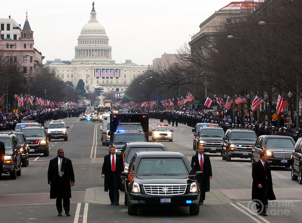 United States President George W. Bush's limousine is surrounded by Secret Service Agents during a parade along Pennsylvania Ave following his inauguration in Washington DC Thursday 20 January 2005. This was the 55th Presidential Inaugurational and will mark the start of Bush's second term in office.