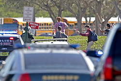 Students run wth their hands in the air outside of Stoneman Douglas High School in Parkland, FL, USA, after a shooting on Wednesday, February 14, 2018. Photo by John McCall/Sun Sentinel/TNS/ABACAPRESS.COM