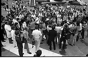 1983-15-08.15th August 1983.15-08-1983.08-15-83..Photographed at Dublin Airport..Pressed:..Gold medalist Eamonn Coughlan geeeted by press and supporters on the tarmac of Dublin Airport on his return from the World Athletic Championships in Finland. His wife Yvonne and chldren Suzanne (four) and Eamonn Jn (two) are with him. Suzanne is in his arms while his wife holds Eamonn Jn. His mother Kathleen is beside Yvonne. .