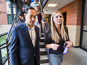 01 NOVEMBER 2019 - DES MOINES, IOWA: JULIAN CASTRO, former Secretary of Housing and Urban Development in the Obama Administration, and EMILY OSWEILER tour the YMCA Supportive Housing Campus. Secretary Castro, who is running for the Democratic nomination for the US presidency, toured the YMCA Supportive Housing Campus in downtown Des Moines Friday. The campus is the only project of its type in the US. It provides transitional housing in the form of individual apartments (rather than dorms) for at risk people rent is needs tested so poverty does not prevent people from getting apartments. There are about 140 apartments in the complex, the YMCA has a waiting list of 119 people. Castro toured the campus before he spoke at the Liberty and Justice Celebration downtown.         PHOTO BY JACK KURTZ