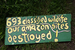 A sign placed by HS2 Rebellion activists at the Denham Protection Camp on 13th July 2020 in Denham, United Kingdom. The environmental activists are seeking to hinder or prevent work on the HS2 project, which is currently projected to cost around £106bn and will remain a net contributor to CO2 emissions during its projected 120-year lifetime.