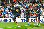 Leeds United forward Eddie Nketiah (14) Leeds United defender Barry Douglas (3) Leeds United midfielder Jamie Shackleton (46) warming up during the EFL Cup match between Leeds United and Stoke City at Elland Road, Leeds, England on 27 August 2019.