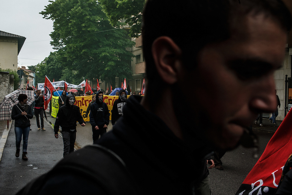 23.5.2015, Gorizia-Gorica, Italy<br /> Rally of antifascist organisations and all common people from Gorizia and other regions of Slovenija and Italy wich oppose to neofascistic ideology. They organised rally to oppose neofascist rally in Gorizia with slogan: &raquo;Fascists get out of Gorizia!&laquo; People were holding crosses with Slovenian, Italian and German names of killed people because of fascist opression from 1915 to 1943 to remined opposite side of her sins. Slovenian supporters were stopped and legitimated at the Slovene-Italian border. Police confiscated them flags, because were attached to sticks wich could be used for street battle, they officially said. But on the other side (on fascists rally)everyone was upholding a flag on stick. So much about justice. They marched arround city center guarded and blocked by heavily armed police squads.