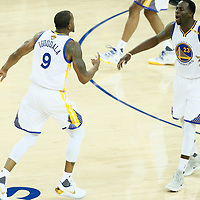 01 June 2017: Golden State Warriors forward Andre Iguodala (9) celebrates with Golden State Warriors forward Draymond Green (23) during the Golden State Warriors 113-90 victory over the Cleveland Cavaliers, in game 1 of the 2017 NBA Finals, at the Oracle Arena, Oakland, California, USA.