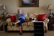 Debbie Ingram poses for a photograph at her home on July 22, 2014 in Argyle, Texas. Just 385 feet behind her home is a gas well that was last fracked in March. (Cooper Neill for The Texas Tribune)