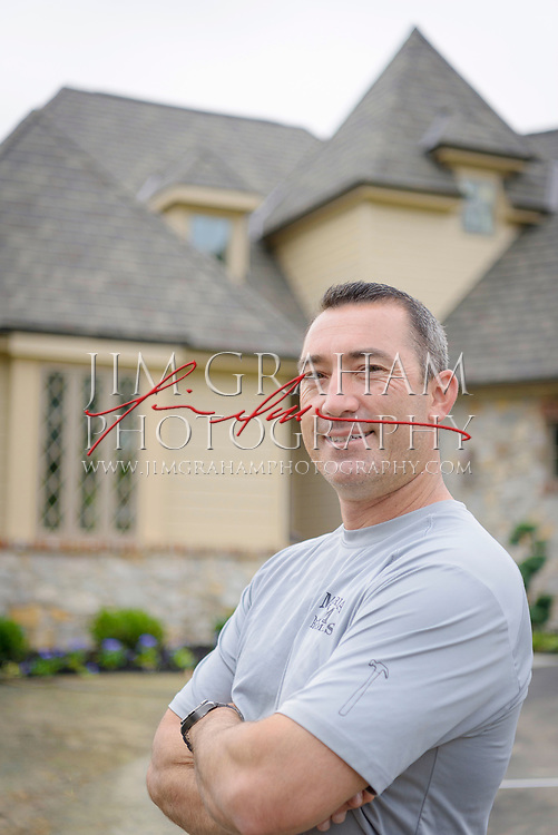 Adrian Donofrio of Marra Homes poses outside one of his company's Château Lane homes in Greenville, De. on Friday 16 June 2017. Photograph by Jim Graham.