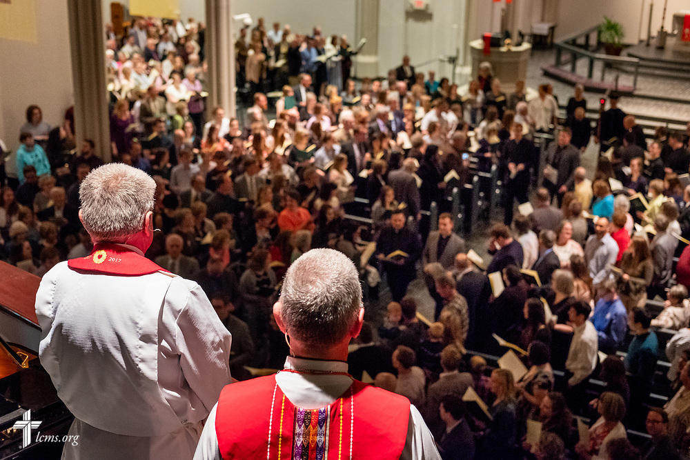 Dr. Dale A. Meyer, president of Concordia Seminary, St. Louis, and the Rev. Dwayne Lueck, president of the LCMS North Wisconsin District, look from the balcony as pastors-elect leave the Service of Praise with Assignment of Calls in the Chapel of St. Timothy and St. Titus at the seminary on Tuesday, April 24, 2018. LCMS Communications/Erik M. Lunsford