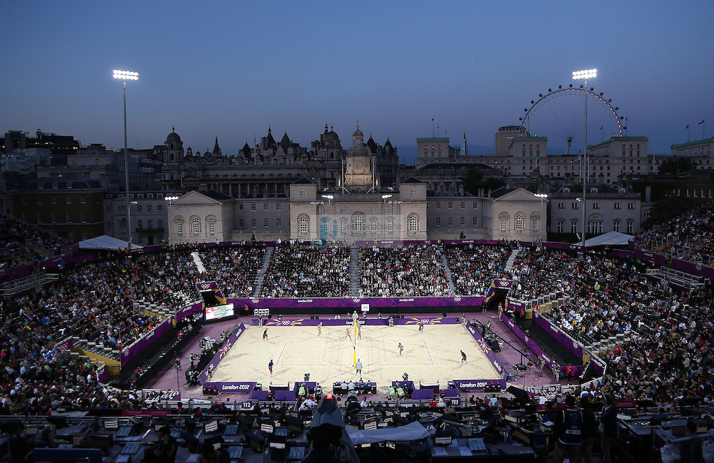 Simone Kuhn and Nadine Zumkehr from Switzerland (left) compete against Maria Tsiartsiani and Vasiliki Arvaniti from Greece during beach volleyball at Horse Guards Park on day 1 of the Olympic Games London, England, United Kingdom on 28 Jul 2012..(Jed Jacobsohn/for The New York Times)....