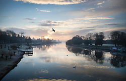 © Licensed to London News Pictures. 28/12/2016. London, UK. Hampton Court on the River Thames at first light. A very cold start to the day in some parts of the UK with temperatures well below freezing at dawn. Photo credit: Peter Macdiarmid/LNP
