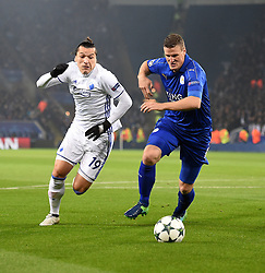 Federico Santander of FC Copenhagen and Robert Huth of Leicester City chase down the ball. - Mandatory by-line: Alex James/JMP - 10/01/2014 - FOOTBALL - King Power Stadium - Leicester, England - Leicester City v FC Copenhagen - UEFA Champions League