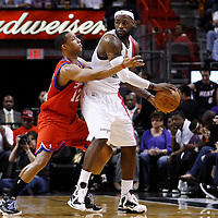 21 January 2012: Philadelphia Sixers shooting guard Evan Turner (12) defends on Miami Heat small forward LeBron James (6) during the Miami Heat 113-92 victory over the Philadelphia Sixers at the AmericanAirlines Arena, Miami, Florida, USA.