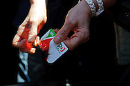 Roma 18 Aprile 2013.Proteste davanti a Montecitorio  per la candidatura di Franco Marini alla Presidenza della Repubblica da parte del Partito Democratico. Un iscritto del Partito democratico brucia la tessera del partito.