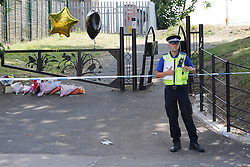 © Licensed to London News Pictures.16/07/2013. Soth Yardley, Birmingham, UK. The scene in Wash Lane, South Yardley, Birmingham, where a fifteen year old boy was stabbed at the entrance to the nearby park. Pictured, the scene of the stabbing. Photo credit : Dave Warren/LNP