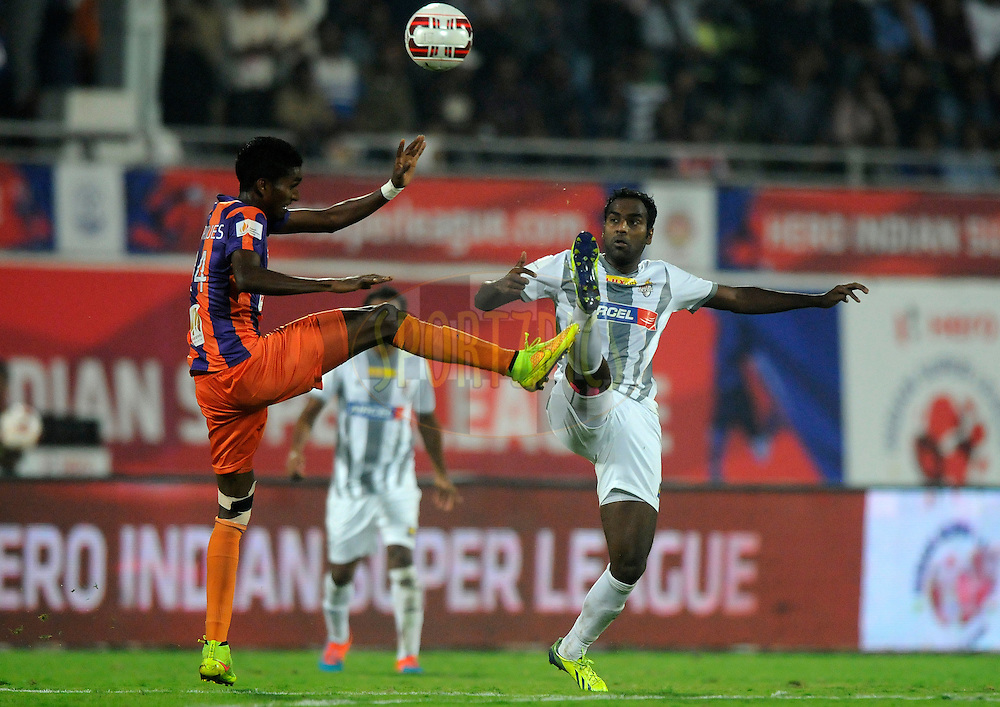 Israil Gurung of FC Pune City and Rakesh Masih of Atletico de Kolkata during match 44 of the Hero Indian Super League between FC Pune City and Atletico de Kolkata FC held at the Shree Shiv Chhatrapati Sports Complex Stadium, Pune, India on the 29th November 2014.<br /> <br /> Photo by:  Pal Pillai/ ISL/ SPORTZPICS
