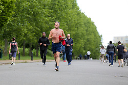 © Licensed to London News Pictures. 02/05/2020. London, UK. People walking and jogging in Finsbury Park, north London during the lockdown over the spread of COVID-19. The government has ordered that people go out for one form of exercise a day, shopping for basic necessities, any medical need, to provide care or to help a vulnerable person and travel to and from work and to keep 2 meters away from other people at all times to slow the spread of the coronavirus and reduce pressure on the NHS. Photo credit: Dinendra Haria/LNP
