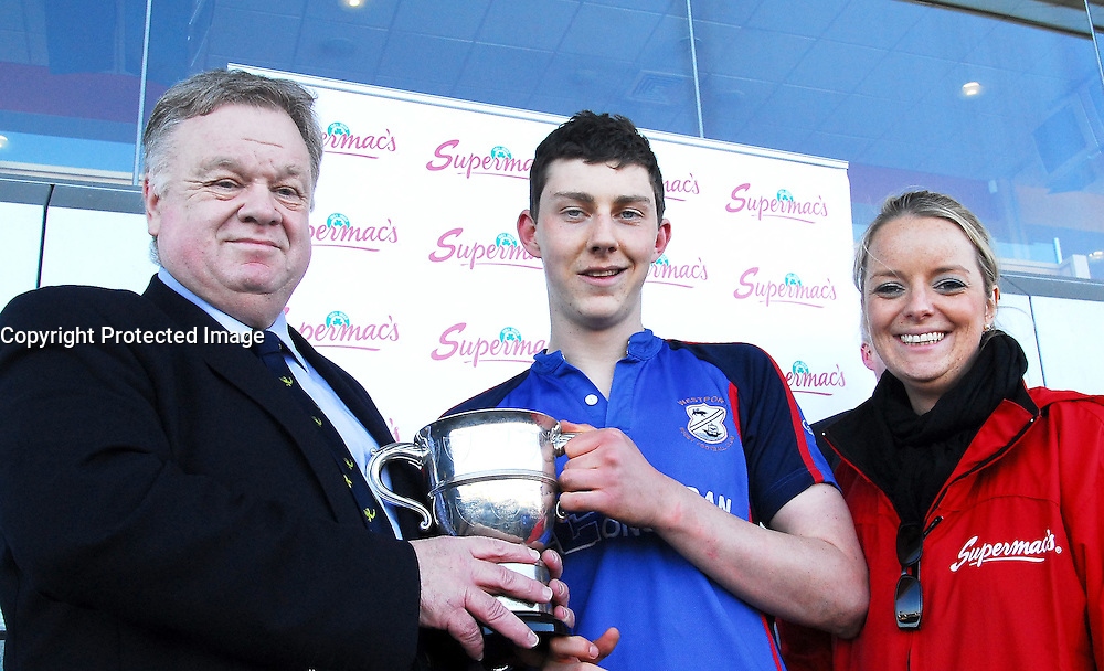 Rice College Westport Captain Sean Tobin is presented Connacht Schools Junior Cup by Connacht Branch president  Jim Foy and Supermac's...Pic Conor McKeown