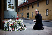 Oslo, Norway, 23.07.2011. A man is laying down flowers and lighting candles in close to where the bomb went off in downtown Oslo. Oslo awakes to shocking messages of the total bodycount after yesterdays massacre. A total of 91 persons were killed in the massacre in Utøya right outside Oslo. Seven of those died when a car bomb was detonated outside the main government biuilding in the heart of Oslo, friday 22. of July. Foto: Christopher Olssøn.