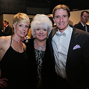 Michelle Hackman, left, Elizabeth Barnes, center, and Colin Hackman pose for a picture during the Diamonds and Champagne Hope Ball Saturday November 22, 2014 at the Coastline Convention Center in Wilmington, N.C. (Jason A. Frizzelle)
