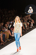Faded blue demin jeans with a white and pastel floral-print top with a Peter Pan collar.