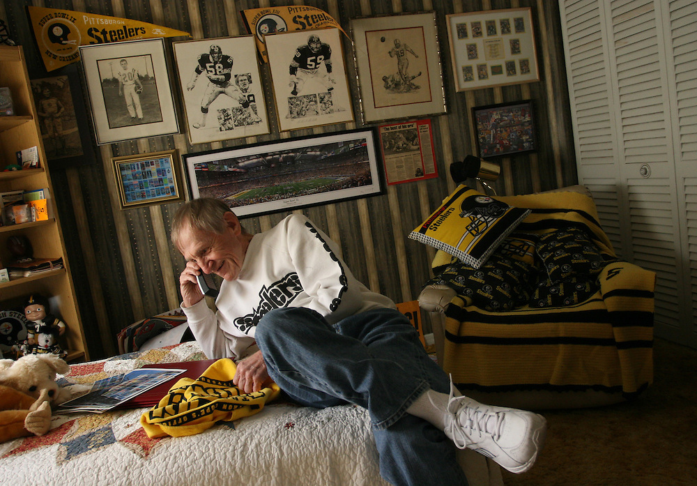 Tom Henschel, age 67, recalls his favorite Super Bowl experience at his Town 'N Country home during a phone interview with Michael Irvin.  A diehard Pittsburgh Steeler fan, Henschel has filled his spare bedroom with Steeler memorabilia. He has been to every Super Bowl since 1967.