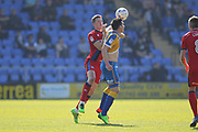 Jim McNulty challenges Louis Dodds during the EFL Sky Bet League 1 match between Shrewsbury Town and Rochdale at Greenhous Meadow, Shrewsbury, England on 8 April 2017. Photo by Daniel Youngs.