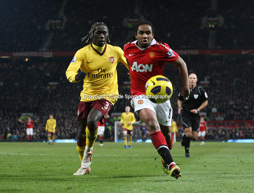 13/12/2010 - Barclays Premier League - Manchester United vs. Arsenal - Anderson of Man Utd battles with Bacary Sagna of Arsenal - Photo: Simon Stacpoole / Offside.