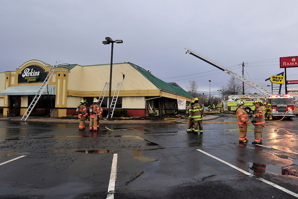 3/30/2013 Whitehall, PA Firefighters battle a 2-alarm fire at the Perkins restaurant on MacArthur Road in Whitehall Sunday evening. Photo | CHRIS POST