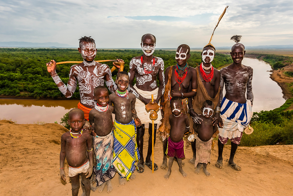 Kara tribe people near the village, with the Omo River behind, Dus, Omo Valley, Ethiopia.