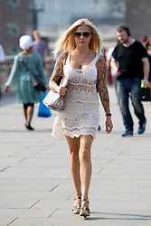 © Licensed to London News Pictures. 26/07/2018. London, UK. A woman in a summery dress walks over London Bridge on what is predicted to be the hottest day of the year. Temperatures in the capital are set to rise up to 35 degrees, as the UK experiences a prolonged heatwave. Photo credit : Tom Nicholson/LNP