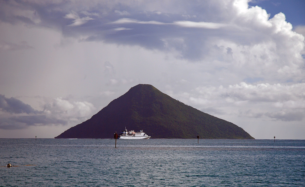 Cruise liner anchored in front of Tafahi volcanic island, Tonga.