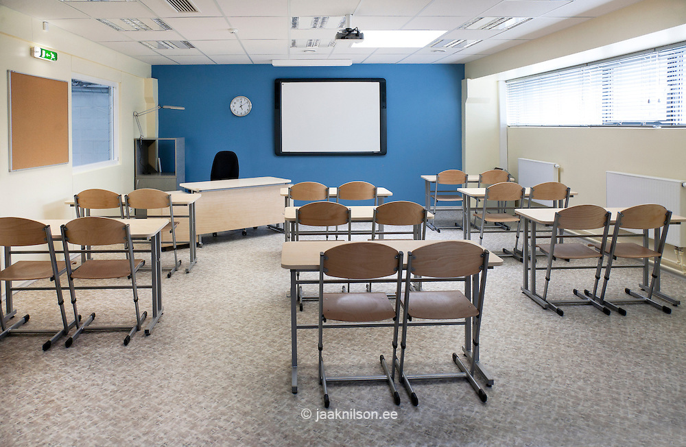 Lecture room with tables and chairs. Hall or classroom in Vana-Vigala Technical and Service School in Estonia