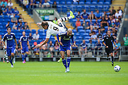 Fulham's Matt Smith takes a tumble  during the Sky Bet Championship match between Cardiff City and Fulham at the Cardiff City Stadium, Cardiff, Wales on 8 August 2015. Photo by Shane Healey.