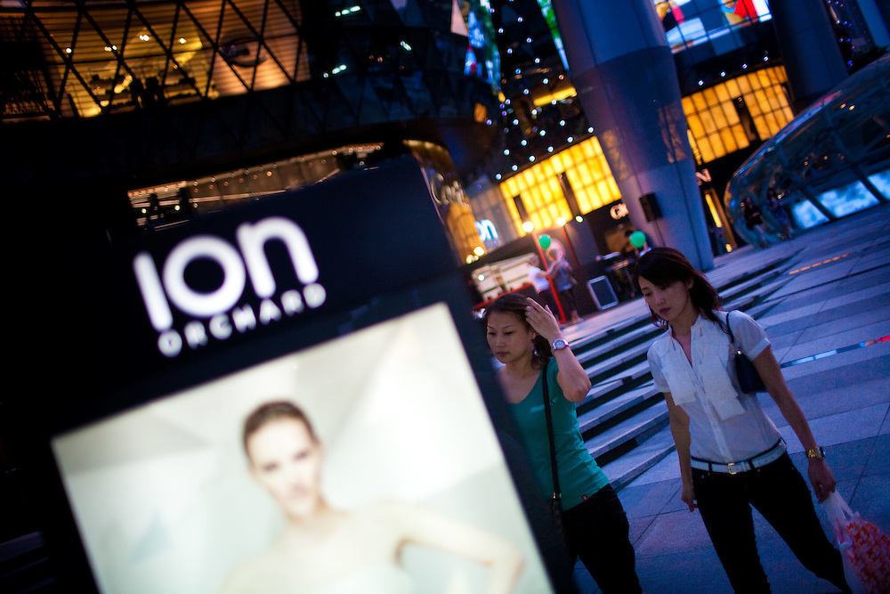 Two female pedestrians pass by ION Orchard, the newest mall on Singapore's famous Orchard Road.