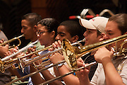 "Youth Orchestra of Caracas rehearsing at the basement of the ""Centro Latinoamericano de Accio?n Social por la Mu?sica (Center for Social Action Through Music)"". The ""Fundacion del Estado para el Sistema Nacional de las Orquestas Juveniles e Infantiles de Venezuela"" (FESNOJIV, National Network of Youth and Children Orchestras of Venezuela), also known as El Sistema, is a publicly financed private-sector music-education program in Venezuela, originally called Social Action for Music, founded 1975 by Venezuelan economist and amateur musician Jose? Antonio Abreu."