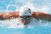 Jul 31 2009; Rome Italy; Michael Phelps (USA) competing in qualification round of the mens 100m butterfly at the 13th Fina World Aquatics Championships held in the The Foro Italico Swimming Complex. Mandatory credit: Mitchell Gunn-US PRESSWIRE