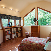 WILMINGTON, DE - AUGUST 8, 2016: A second floor guest room features the same exposed laminated Canadian pine beams and custom geometric windows found throughout the house. 19 Crestfield Road, Wilmington, DE. Credit: Albert Yee for The New York Times