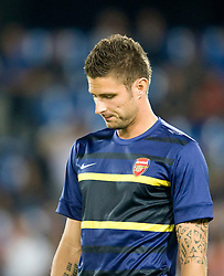 Olivier Giroud of Arsenal warms up before the Champions League group match between Montpellier and Arsenal at the Stade la Mosson, Montpellier, France, 18th September 2012. Eoin Mundow/Cleva Media