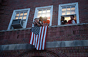Ohio University students watch the Presidential motorcade from their dorm room at Ohio University.  Photo by Ben Siegel/ Ohio University