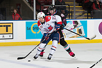 KELOWNA, BC - SEPTEMBER 21:  Jake Lee #21 of the Kelowna Rockets back checks Eli Zummack #29 of the Spokane Chiefs as he skates with the puck at Prospera Place on September 21, 2019 in Kelowna, Canada. (Photo by Marissa Baecker/Shoot the Breeze)