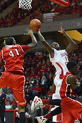 04 February 2012:  Taylor brown slips under John Wilkins but can't stop the shot as Anthony Thompson also tries for a block on the high side during an NCAA Missouri Valley Conference mens basketball game where the Bradley Braves lost to the Illinois State Redbirds 78 - 48 in Redbird Arena, Normal IL